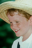 Young boy dressed as Huck Finn from Mark Twain for community celebration July 4, Hannibal MO