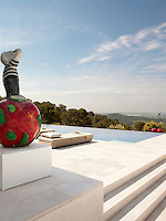 An outside terrace provides the perfect place for sun-bathing and gives a fabulous view of the countryside beyond. A figurative piece by Daniel Wagenblast scans the horizon.
