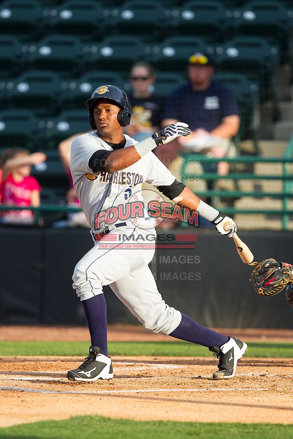Miguel Andujar (5) of the Charleston RiverDogs follows through on his swing against the Hickory Crawdads at L.P. Frans Stadium on June 2, 2014 in Hickory, North Carolina.  The Crawdads defeated the RiverDogs 9-6.  (Brian Westerholt/Four Seam Images)