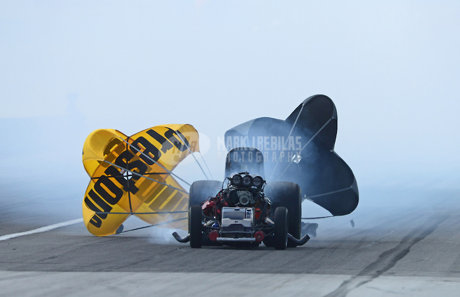 Sept 9, 2012; Clermont, IN, USA: NHRA funny car driver Todd Lesenko blows the body off his car in a fiery explosion during the US Nationals at Lucas Oil Raceway. Mandatory Credit: Mark J. Rebilas-