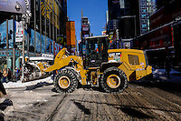 A truck removes snow from the streets of Times Square after the pass of the winter storm JONAS, in New York, 01/24/2016. Photo by VIEWpress