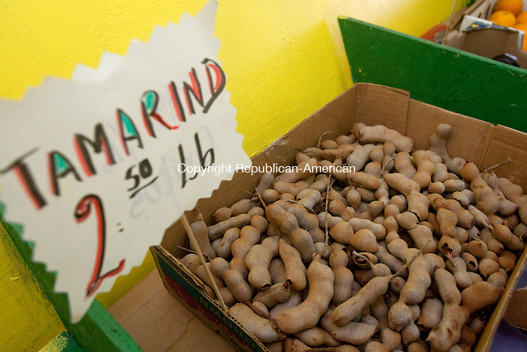 TORRINGTON, CT 15  JULY, 2010-07150JS01-Tamarind is one of the many ethnic foods carried by Jose Cuzco, the owner of Tino's Fruit Market located on Main Street in Torrington. Cuzco travels to New York City once a week to buy produce he can't find in Connecticut that is familiar to his Hispanic customers.  The sweet and sour fruit inside the pods of the tamarind tree is generally used for making juice, but is also as a snack and used in cooking. <br /> Jim Shannon Republican-American