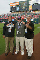 ANAHEIM, CA - OCTOBER 19: Photographers Mickey Palmer, V.J. Lovero, and John Iacono pose for a picture before Game 1 of the World Series between the San Francisco Giants and Anaheim Angels at Edison Field in Anaheim, California on October 19, 2002. (Photo by Brad Mangin