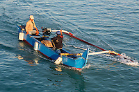 Jimbaran, Bali, Indonesia.  Fishermen Coming in with Early Morning Catch.