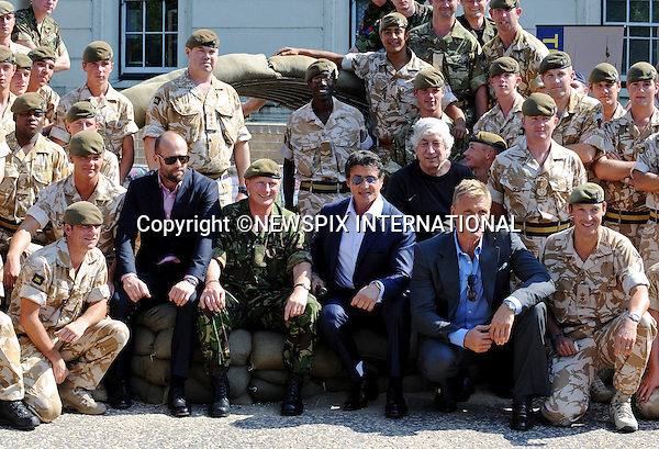 """SYLVESTER STALLONE, DOLPH LUNDGREN AND JASON STATHAM.visited the Prince of Wales Royal Regiment at Wellington Barracks, London..The stars of """"Expendables"""" got the chance to the feel of some of the high powered weaponry at the base_09/08/2010..Photo Credit: ©Harmer_Newspix International..**ALL FEES PAYABLE TO: """"NEWSPIX INTERNATIONAL""""**..PHOTO CREDIT MANDATORY!!: NEWSPIX INTERNATIONAL..IMMEDIATE CONFIRMATION OF USAGE REQUIRED:.Newspix International, 31 Chinnery Hill, Bishop's Stortford, ENGLAND CM23 3PS.Tel:+441279 324672  ; Fax: +441279656877.Mobile:  0777568 1153.e-mail: info@newspixinternational.co.uk."""