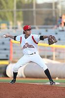 Kirk Singer #13 of the Salem-Keizer Volcanoes pitches against the Spokane Indians at Volcanoes Stadium on July 26, 2014 in Keizer, Oregon. Spokane defeated Salem Keizer, 4-1. (Larry Goren/Four Seam Images)