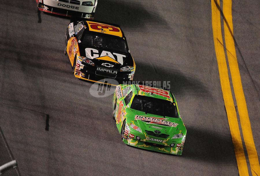 Jul. 3, 2010; Daytona Beach, FL, USA; NASCAR Sprint Cup Series driver Kyle Busch (18) leads Jeff Burton (31) during the Coke Zero 400 at Daytona International Speedway. Mandatory Credit: Mark J. Rebilas-