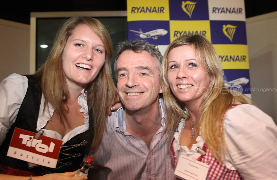 ***NO FEE PIC***.28/01/2011.Ryanair CEO Michael O' Leary with (L to R) Barbara Klaunzner from Tirol Tourism & Claudia Haid from Hotel Hochfilzer at the Travel Clinic during the Holiday World Show in the RDS, Dublin..Photo: Gareth Chaney Collins