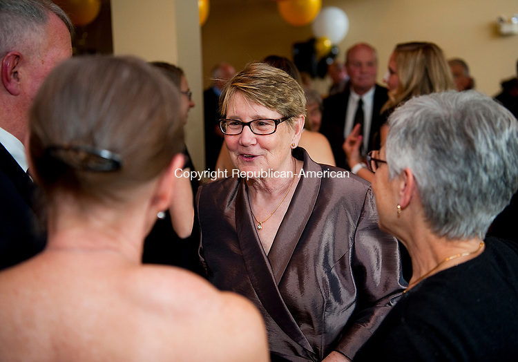 TORRINGTON,  CT-051217JS01- Katherine Marchand-Beyer, Director of Community Support for LARC and Director of Camp Moe, is greeted by supporters as she was honored as 2017 Woman of the United Way Women&rsquo;s Leadership Initiative Committee. A gala was held Friday at the Torrington Country Club,  in honor of Marchand-Beyer as well as Kara Oneglia, a vice president at O&amp;G Industries, for best supporting woman in the role of business and Isabelle Carrington, director of education at Warner Theatre for best supporting woman in the role of the art. <br />  Jim Shannon Republican-American