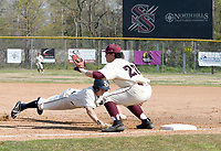 Bud Sullins/Special to the Herald-Leader<br /> Siloam Springs first baseman A.J. Serrano waits for a pickoff throw at first base against Greenwood in a game on April 9 at James Butts Baseball Park.