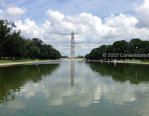 Washington Monument in Washington, D.C. from the western edge of the Reflecting pool showing the scaffolding in place on July 14, 2013.<br /> The scaffolding is part of the repair and restoration work following the earthquake on August 23, 2011.<br /> Credit: Ron Sachs