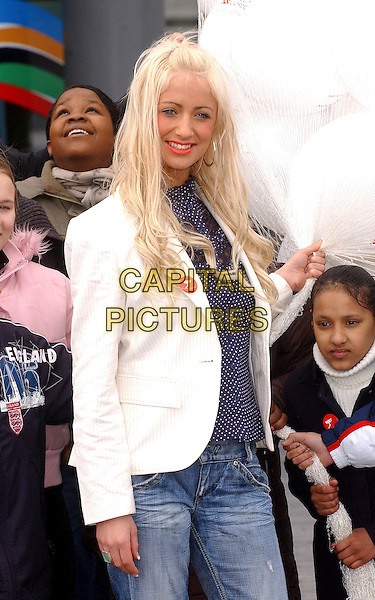 "CHANTELLE HOUGHTON.Launch of ""Bullywatch"" charity - press launch & photocall outside Greater London Authority, City Hall, London, UK.  .March 22nd, 2006.Ref: BEL.half length white pinstripe jacket blue polka dot top .www.capitalpictures.com.sales@capitalpictures.com.© Capital Pictures."