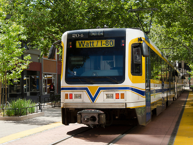 Sacramento lightrail system trains running downtown.