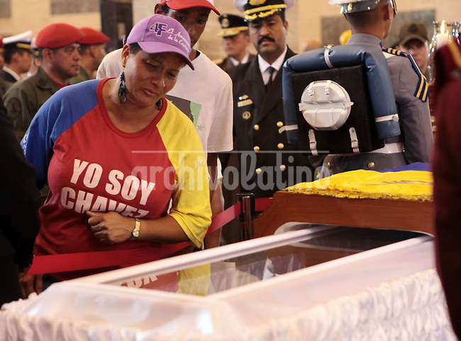 during the funeral of Commander Hugo Chavez, Presdient of Venezuela during the last 14 yearsPeople express their sorrow during the funeral of Commander Hugo Chavez, Presdient of Venezuela during the last 14 years