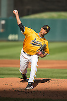 Blake Hickman (18) of the Iowa Hawkeyes pitches during a 2015 Big Ten Conference Tournament game between the Iowa Hawkeyes and Michigan Wolverines at Target Field on May 20, 2015 in Minneapolis, Minnesota. (Brace Hemmelgarn/Four Seam Images)