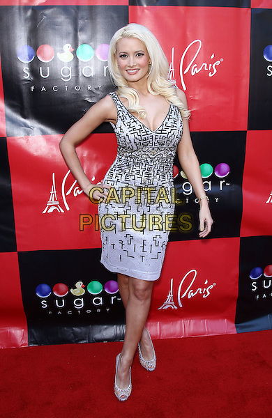"""Holly Madison.Holly Madison hosts a book signing for her new memoir, """"The Show Girl Next Door: Holly Madison's Las Vegas"""", at Sugar Factory inside Paris Las Vegas, Las Vegas, Nevada, USA  .11th June 2011.full length white black print dress hand on hip  .CAP/ADM/MJT.© MJT/AdMedia/Capital Pictures"""