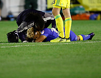 AFC Wimbledon's Lyle Taylor receives attention during the Carabao Cup match between AFC Wimbledon and Brentford at the Cherry Red Records Stadium, Kingston, England on 8 August 2017. Photo by Carlton Myrie.