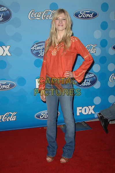 BROOKE WHITE .Attending The American Idol Top 12 Finalist Celebration Held At The Pacific Design Center In West Hollywood,California, USA, .March 6th 2008..full length orange top jeans hand on hip.CAP/DVS.??Debbie VanStory/Capital Pictures