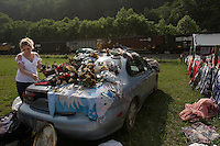 West Virginians have always lived with the backdrop of the coal train going by as they live their lives.  And the money has always seemed to go out of town on the train.  People in Mingo County set up unofficial flea markets daily on the side of the road to sell their clothing and other items for income.