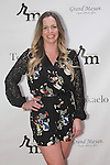 Courtney Morrome the 3rd Annual Wives' Holiday Soiree at Totokaelo in SOHO on December 9, 2015.