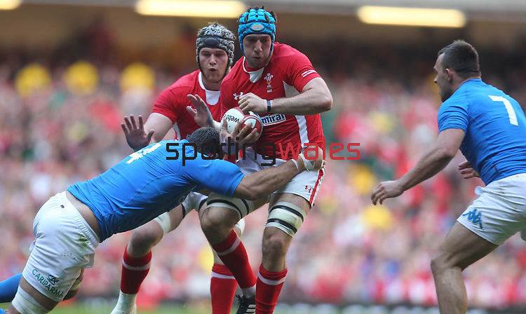 Quintin Geldenhuys tacles Justin Tipuric..2012 RBS 6 Nations.Wales v Italy.Millennium Stadium..10.03.12.Credit: STEVE POPE-Sportingwales