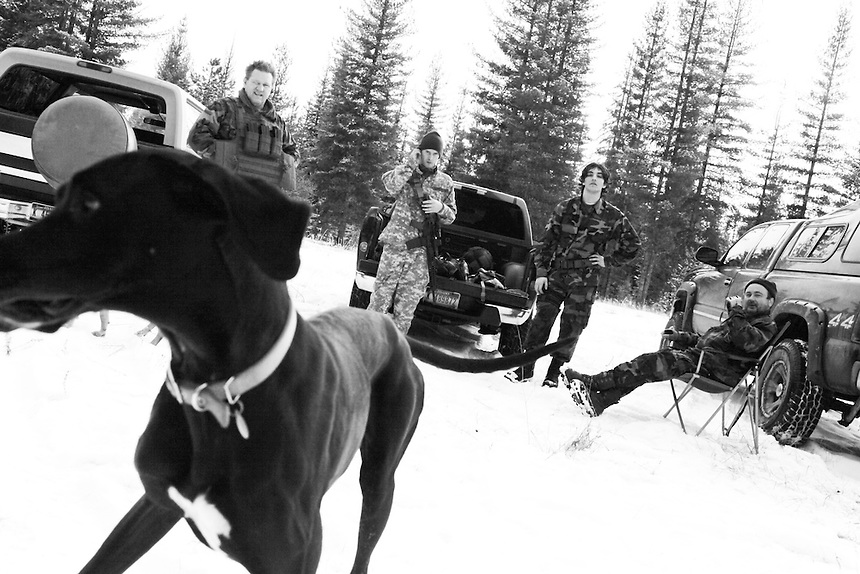 Members of the Idaho Light Foot Militia relax by their vehicles as a dog of member Jeff Stankiewicz runs around their camp.