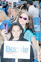 Supporters of Democratic presidential candidate Bernie Sanders wait to march before the Labor Day Parade in Milford, New Hampshire, on Mon., September 2, 2019. Candidates Bernie Sanders and Vermin Supreme were the only candidates who marched in the parade this year.