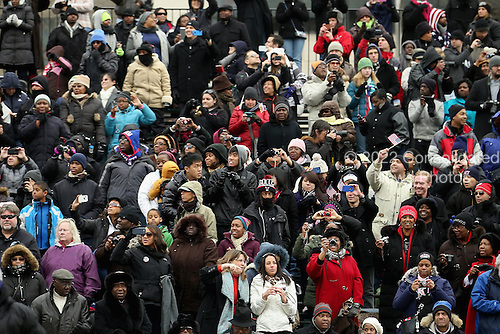 Supporters fill the bleachers and take photographs as U.S. President Barack Obama's motorcade travels from the White House to the U.S. Capitol along Pennsylvania Avenue January 21, 2013 in Washington, DC. Obama and U.S. Vice President Joe Biden will begin their second term in office by taking the Oath of Office later in the morning during a ceremony on the West Front of the U.S. Capitol.  .Credit: Chip Somodevilla / Pool via CNP
