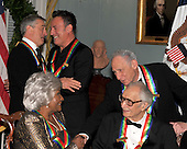 Washington, DC - December 5, 2009 -- 2009 Kennedy Center honorees Robert De Niro and Bruce Springsteen, upper left, embrace as Mel Brooks congratulates Grace Bumbry after they posed for the formal group photo following the Artist's Dinner at the United States Department of State in Washington, D.C. on Saturday, December 5, 2009.  Dave Brubeck looks on from lower right..Credit: Ron Sachs - Pool via CNP