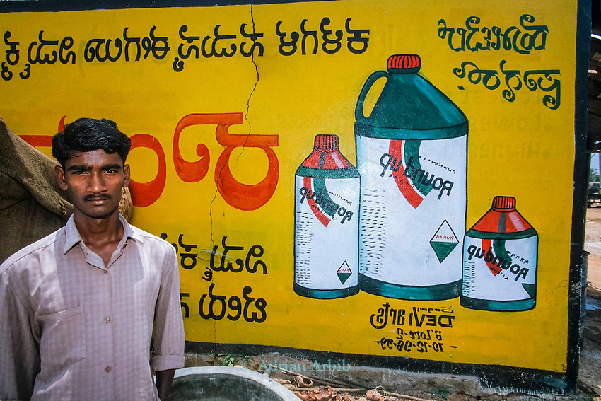 Advert for  Monsanto Round Up herbicide in a rural Indian Village