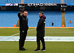 Ex Manchester City manager Stuart Pearce (l) takes a walk on the pitch as a West Ham United coach during the premier league match at the Etihad Stadium, Manchester. Picture date 3rd December 2017. Picture credit should read: Andrew Yates/Sportimage
