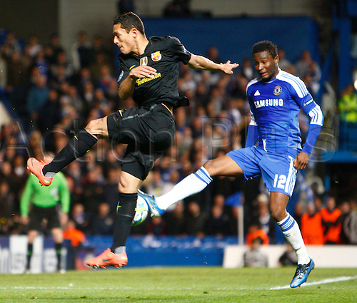 18.04.2012. Stamford Bridge, Chelsea, London. Adiano of FC Barcelona and Chelsea's Nigerian footballer John Obi Mikel .during the Champions League Semi Final 1st  leg match between Chelsea and Barcelona  at Stamford Bridge, Stadium on April 18, 2012 in London, England.............