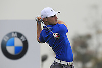Oliver Fisher (ENG) tees off the 2nd tee during Thursday's Round 1 of the 2014 BMW Masters held at Lake Malaren, Shanghai, China 30th October 2014.<br /> Picture: Eoin Clarke www.golffile.ie