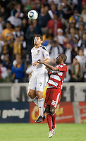 CARSON, CA – NOVEMBER 14: LA Galaxy defender Omar Gonzalez (4) and FC Dallas forward Atiba Harris (16) during the Western Conference Final soccer match at the Home Depot Center, November 14, 2010 in Carson, California. Final score LA Galaxy 0, Dallas FC 3.