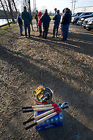 Volunteers gather at Otterbein Lake in Westerville, Ohio, on a cold winter morning to clear brush and debris from the once abandoned lake that was used as a holding pond for industry. In foreground are the tools of their jobs.  Photo Copyright Gary Gardiner. Not for reproduction without written permission.