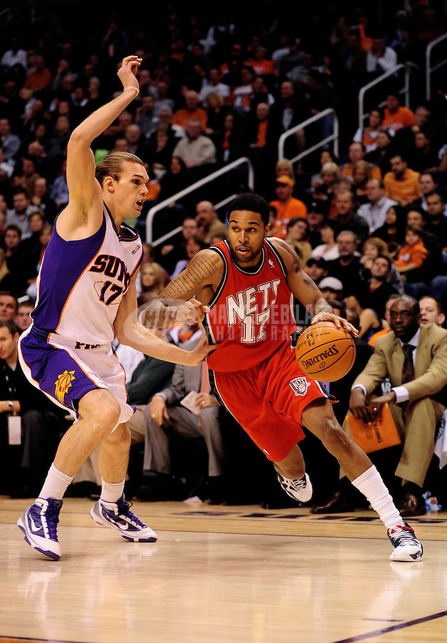 Jan. 20, 2010; Phoenix, AZ, USA; New Jersey Nets forward Chris Douglas-Roberts (right) drives to the basket against Phoenix Suns forward Louis Amundson at the US Airways Center. The Suns defeated the Nets 118-94. Mandatory Credit: Mark J. Rebilas-