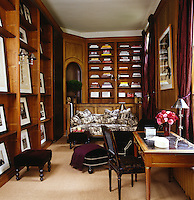 The wood-panelled library has shelves displaying part of an extensive collection of black and white photography that includes works by Lillian Bassman, Bruce Weber and Arthur Elgort