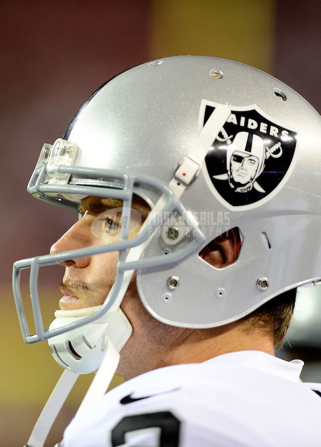 Aug. 17, 2012; Glendale, AZ, USA; Oakland Raiders quarterback Carson Palmer in the first half against the Arizona Cardinals during a preseason game at University of Phoenix Stadium. The Cardinals defeated the Raiders 31-27. Mandatory Credit: Mark J. Rebilas-