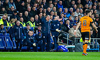 Cardiff City manager Neil Warnock reacts to a challenge on Junior Hoilett of Cardiff City during the Sky Bet Championship match between Cardiff City and Wolverhampton Wanderers at the Cardiff City Stadium, Cardiff, Wales on 6 April 2018. Photo by Mark  Hawkins / PRiME Media Images.