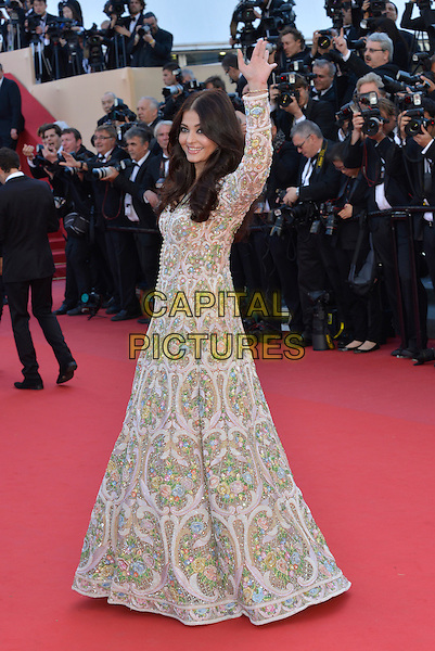 Aishwarya Rai Bachchan .'Blood Ties' premiere at the 66th  Cannes Film Festival, France..20th May 2013.full length white pink green blue pattern embellished jewel encrusted dress long sleeves hand arm in air waving   .CAP/PL.©Phil Loftus/Capital Pictures.