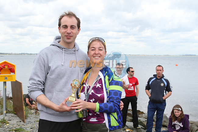 "Sue McKinney presents Oran Kane who came second at the Clogherhead ""Round the Head Swim"".....(Photo credit should read Jenny Matthews/NEWSFILE)..."