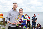 """Sue McKinney presents Oran Kane who came second at the Clogherhead """"Round the Head Swim"""".....(Photo credit should read Jenny Matthews/NEWSFILE)..."""