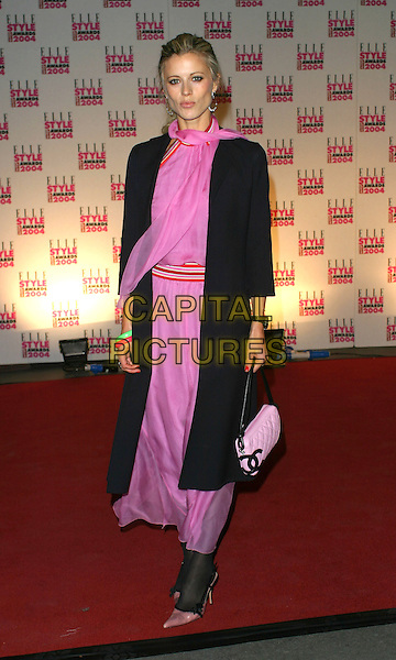 LAURA BAILEY.Elle Style Awards at the Natural History Museum.16 February 2004.full length, full-length, pink scaft dress, black coat, chanel handbag.www.capitalpictures.com.sales@capitalpictures.com.©Capital Pictures