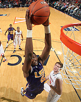 Jan. 2, 2011; Charlottesville, VA, USA; LSU Tigers forward Malcolm White (5) prepares to dunk the ball in front of Virginia Cavaliers forward Will Sherrill (22) during the game at the John Paul Jones Arena. Virginia won 64-50. Mandatory Credit: Andrew Shurtleff-