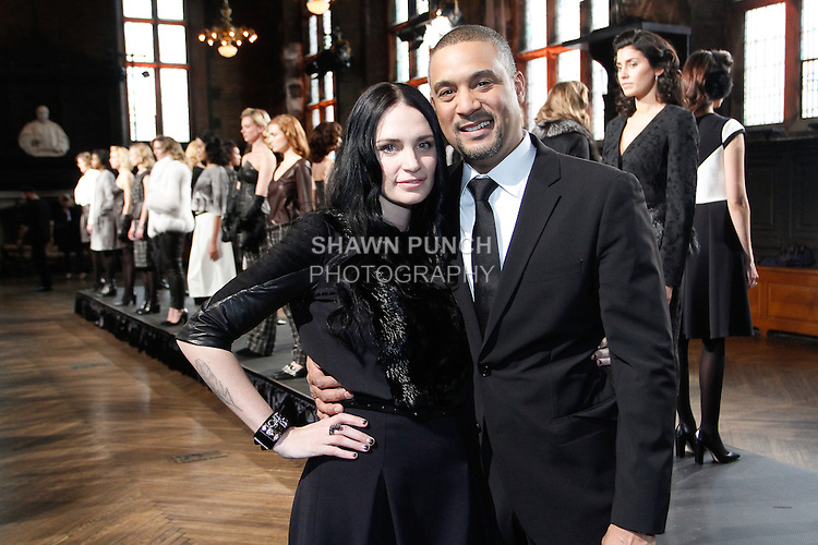 Fashion designer Heather Lawton poses with Paul Chin, in front of models, during the Heather Lawton Fall/Winter 2014 collection presentation at the High Line Hotel, during New York Fashion Week Fall 2014, February 5, 2013.