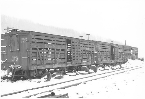 RGS stock cars 7302, 7303, and another sitting in snowy yard.<br /> RGS    Taken by Richardson, Robert W.