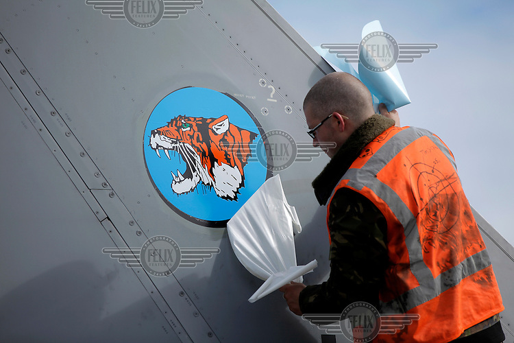 A new tiger sticker is adden to a Dutch F-16. Nato Tiger Meet is an annual gathering of squadrons using the tiger as their mascot. While originally mostly a social event it is now a full military exercise. Tiger Meet 2012 was held at the Norwegian air base Ørlandet.