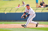 First baseman Barrett Kleinknecht #10 of the Rome Braves stretches for a throw against the Hagerstown Suns at State Mutual Stadium on May 2, 2011 in Rome, Georgia.   Photo by Brian Westerholt / Four Seam Images
