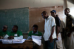Voters inside a polling station wait to receive their ballots to vote in presidential and legislative elections in Port-au-Prince, Haiti.