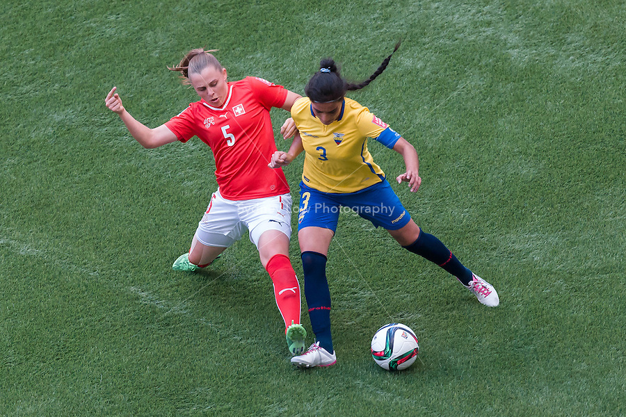 June 12, 2015: Noelle MARITZ of Switzerland and Nancy AGUILAR of Ecuador compete for the ball during a Group C match at the FIFA Women's World Cup Canada 2015 between Switzerland and Ecuador at BC Place Stadium on 12 June 2015 in Vancouver, Canada. Switzerland won 10-1. Sydney Low/AsteriskImages